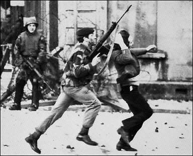 bloodysundayrunningsoldier Rock History 101: U2s Sunday Bloody Sunday