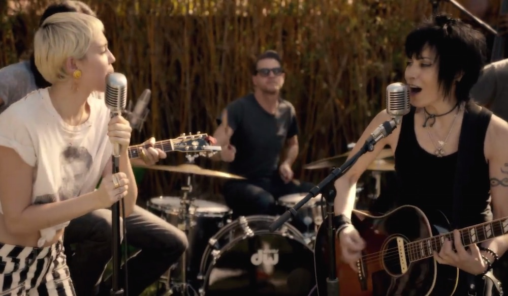 Miley Cyrus And Joan Jett Rock Out In Miley S Backyard Watch Consequence Of Sound