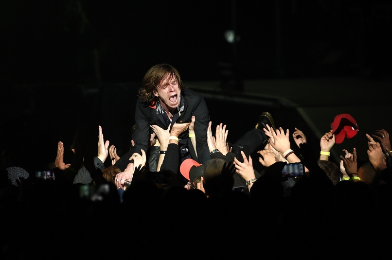 SAN FRANCISCO, CA - FEBRUARY 06: Singer Matt Shultz of Cage the Elephant crowdsurfs while performing at CBS RADIO's third annual 'The Night Before' at AT&T Park on February 6, 2016 in San Francisco, California. (Photo by Kevin Winter/Getty Images for CBS)