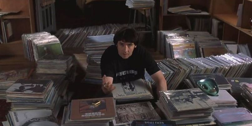 Rob-Gordon-with-his-huge-collection-of-vinyl-in-High-Fidelity