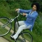 Prince riding a bike