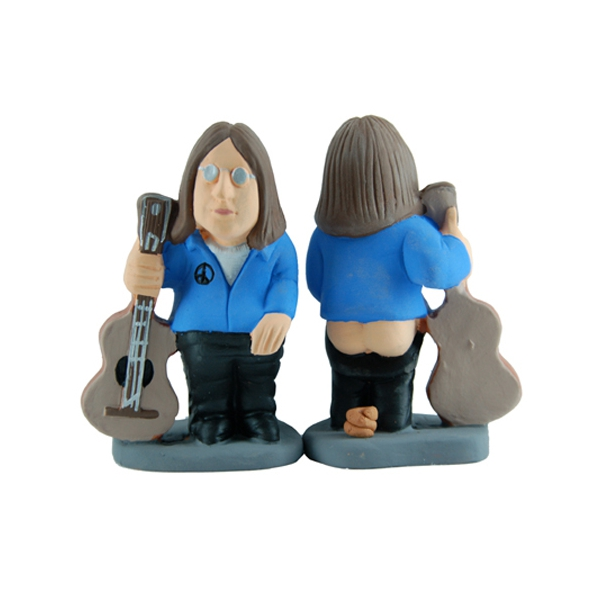 john lennon This Spanish website sells statues of musicians pooping