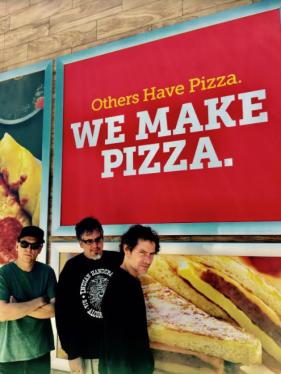 """Enjoying Pizza en route to Portland"""