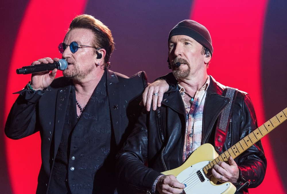 U2's Bono and The Edge busk for the homeless in Dublin on Christmas Eve: Watch
