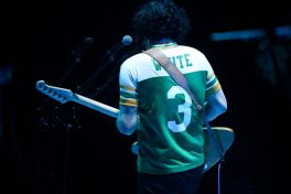 Jack White wearing jersey of his high school alma mater