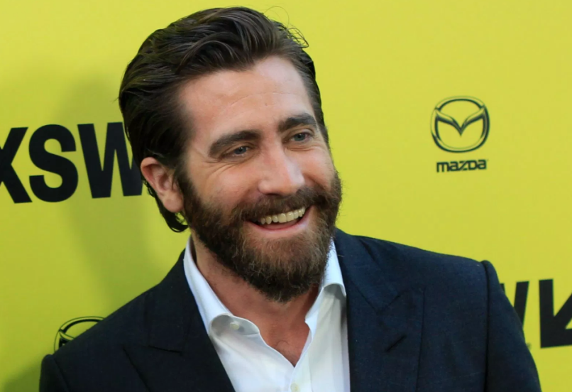 Jake Gyllenhall SXSW Beard Smile Yellow Wall