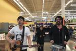 Brett Newski performing in Milwaukee Walmart