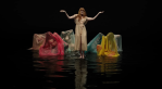 "Florence and The Machine's ""Big God"" video water dance colored sheets"