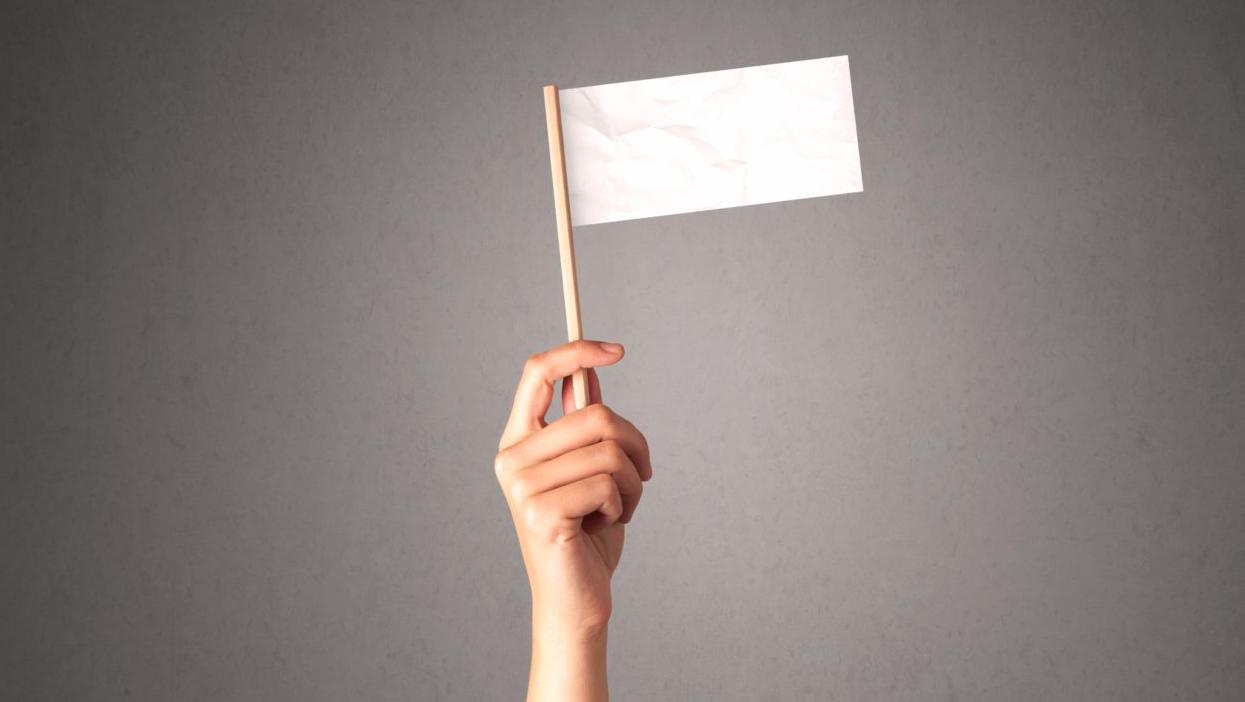 surrender white flag hand