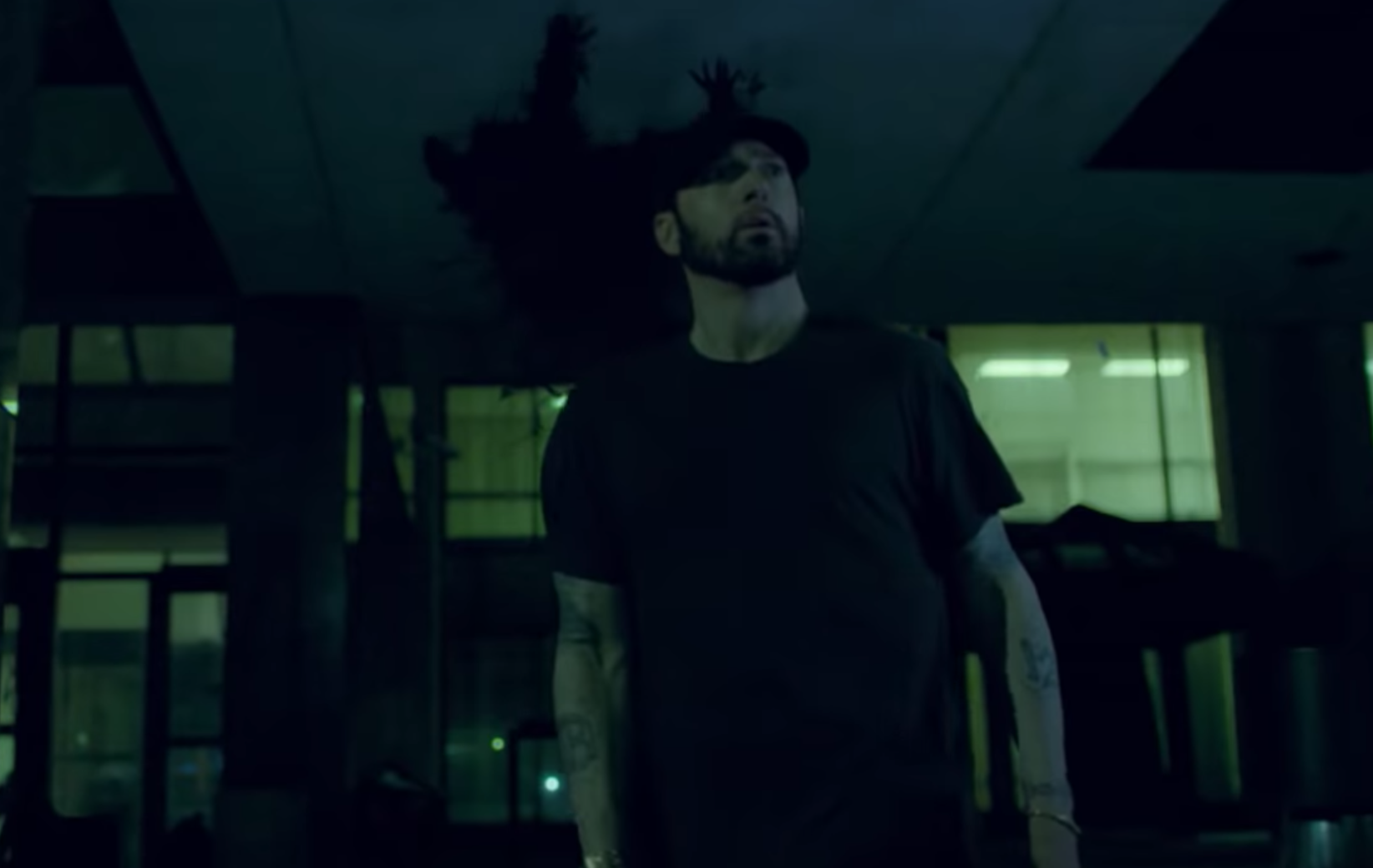 Eminem runs from the specter of his critics in video for