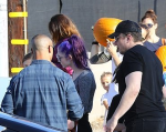 Grimes and Elon Musk at pumpkin patch, photo via The Daily Mail