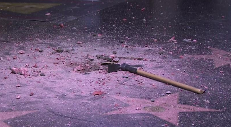 donald trumps hollywood walk of fame star destroyed 1 Pickaxe wielding guitarist listened to Death Grips while destroying Trumps Walk of Fame star