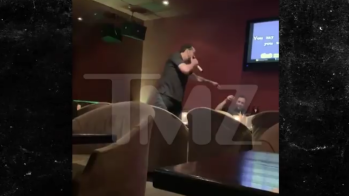 "Nicolas Cage singing Prince's ""Purple Rain"" at karaoke bar"