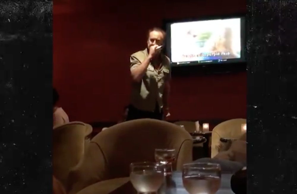 "Nicolas Cage fiercely covers Prince's ""Purple Rain"" at karaoke bar: Watch"