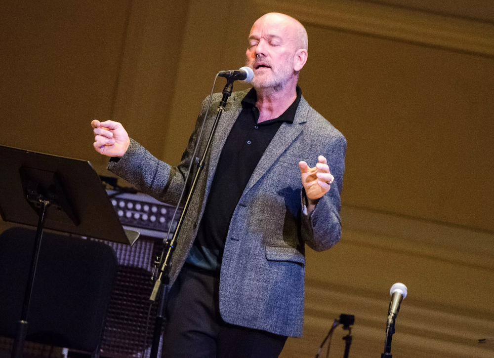 "Michael Stipe debuts new songs ""Your Capricious Soul"" and ""Drive to the Ocean"" in NYC: Watch"