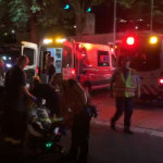 Paramedics transfer injured festival-goers following Bumbershoot barricade collapse