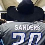 Garth Brooks wearing Barry Sanders jersey