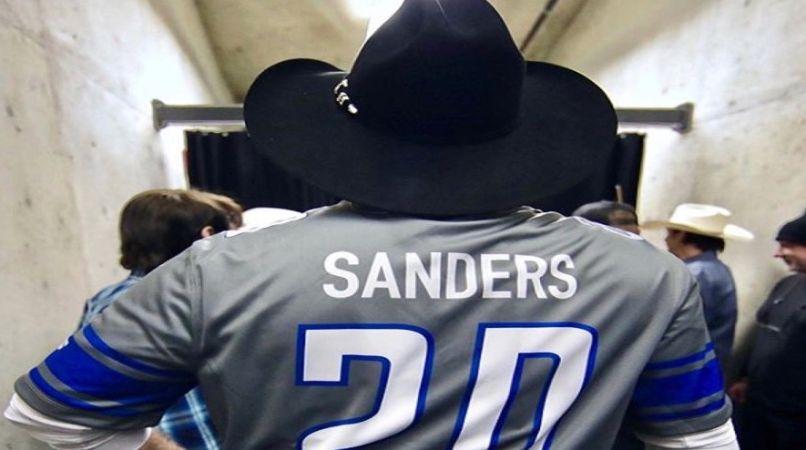 Garth Brooks wearing Barry Sanders jersey