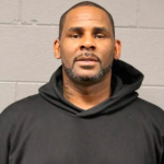R Kelly mugshot trial delay 100 electronic devices