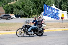 A biker flies a Trump flag during the 80th annual Sturgis Motorcycle Rally on Saturday, Aug. 15, 2020, in Sturgis, S.D. (Amy Harris)