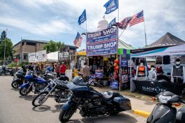 Motorcycles are parked outside of popup stores during the 80th annual Sturgis Motorcycle Rally on Saturday, Aug. 15, 2020, in Sturgis, S.D. (Amy Harris)