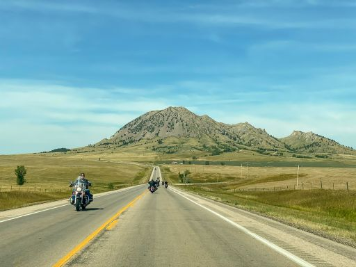 Bikers ride down the highway during the 80th annual Sturgis Motorcycle Rally on Saturday, Aug. 15, 2020, in Sturgis, S.D. (Amy Harris)