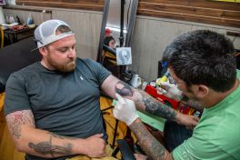 Brandon Taranto receives a tattoo by artist Oddly Strange James during the 80th annual Sturgis Motorcycle Rally on Friday, Aug. 14, 2020, in Sturgis, S.D. (Amy Harris)