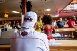 A Trump supporter sits at the bar at One Eyed Jacks during the 80th annual Sturgis Motorcycle Rally on Friday, Aug. 14, 2020, in Sturgis, S.D. (Amy Harris)