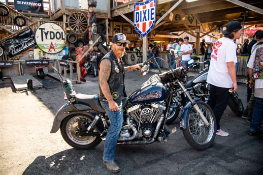 A biker poses for a photo at the Broken Spoke Saloon during the 80th annual Sturgis Motorcycle Rally on Friday, Aug. 14, 2020, in Sturgis, S.D. (Amy Harris)