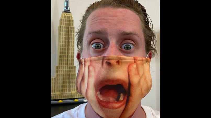 Macaulay Culkin wearing a Home Alone face mask is the best PSA scream mask
