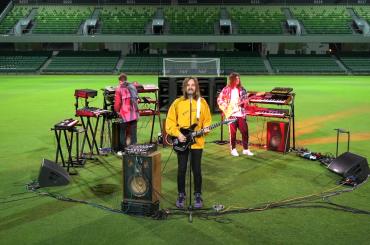 "Tame Impala Perform ""Elephant"", ""Is It True"" in an Empty Soccer Stadium: Watch"