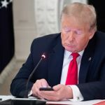 Donald Trump tweeting, photo via Getty